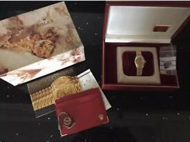 Ladies 18k gold Rolex with box and papers