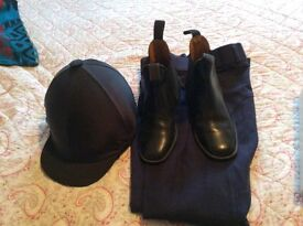 Riding hat, riding boots and jodhpurs