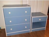 Blue chest of drawers and bedside table with drawer