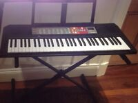 Yamaha PSR F50 portable keyboard for sale with stand. Good as new