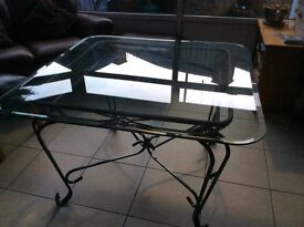 Glass dining table and chairs could be used in the garden