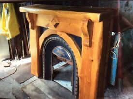 Rustic pine fireplace with horse shoe inset