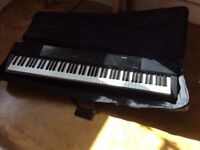 Casio Digital Piano PX-150 with stand and carry case.