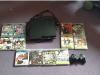 PlayStation 3 with 2 controllers, charging cable, earpiece audio/microphone & 12 games