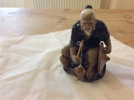 Chinese clay fisherman ornament
