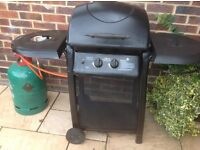 Gas barbeque with pan heater used twice