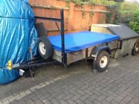750kg well built trailer with H bar and cover.
