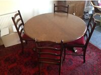 Dark wood round extendable dining table & 4 chairs