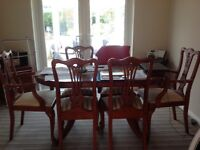 yew wood extendable table and 6 chairs ,chairs in excellent condition but table has a few marks