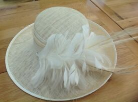 Lovely cream Wedding hat with feathers