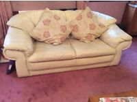 Cream leather corner sofa, two seater sofa, chair, cushions and foot stool
