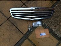 NEW, in box..Mercedes C Class front Grill & Bonnet Badge