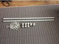 Beautiful white wooden curtain pole and lots of white wooden curtain rings
