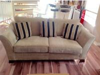 Three piece suite. 3 seater, 2 seater couches and 2 seater chair and pooffee