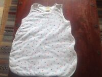 Baby gro bag size 0-3 months, white with polka dots.