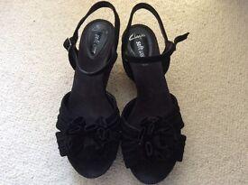 Clarks wedge heel sandals in black, size 5