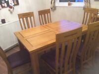 Extending dining table and 6 chairs in goo condition ex Buick's of Montrose