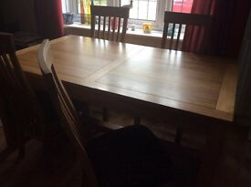 Dining room table with four chairs. Solid oak extendable table that can seat up to eight.