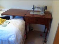 Jones sewing machine within table
