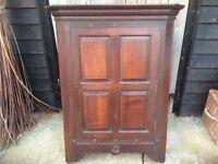 Old dark wood corner cupboard