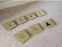 Brass coloured screwless flatplate light switches