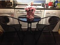 Bistro table and 2 chairs very good condition only used inside