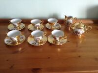 A Set of Six Cups and Saucers of Bavarian China Including a Milk and Sugar Bowl (No Lid)