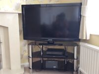 TV corner stand with 3 shelves in black glass and chrome