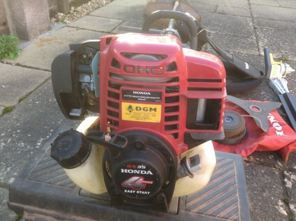 Honda four stroke garden strimmer and hedgecutter