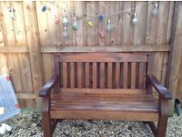 Two so.id wood garden benches for sale.