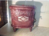 "Wood burning stove. ""Le non pareil"" in pink enamel."