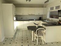 White gloss kitchen, grey worktops, including white goods