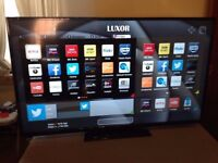 """32"""" FULL SMART LUXOR LUX0132002 FULL HD LED SMART TV WITH BUILT IN FREE VIEW IN PERFECT CONDITION."""