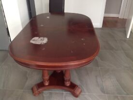 Free Solid table for sale. No chairs. Few marks on surface , but will last a hundred years.
