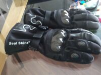 Black motorcycle Helmet & Pair of Seal Skinz motorcycle gloves