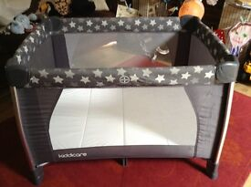 Kiddicare travel cot with mattress.
