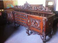 Heavily carved Spanish walnut sideboard