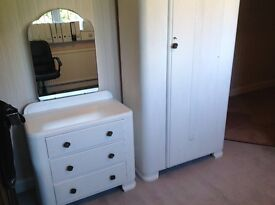 White wardrobe with matching dresser and headboard
