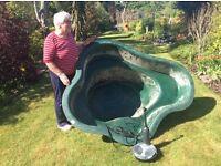 Garden pond with fountain pump