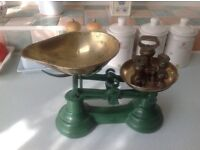 Old fashion kitchen scales in green with all its separate weights ,excellent condition .