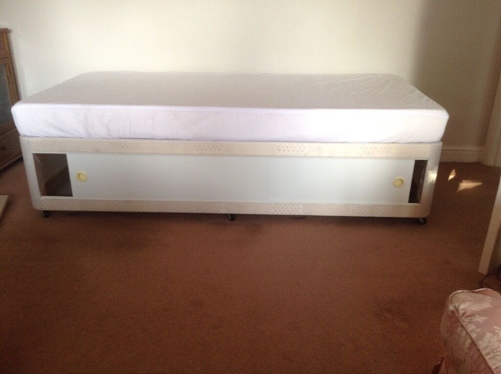 Single bed with sliding doors, foam mattress all new