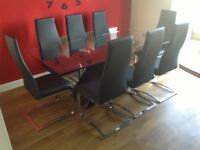 Glass top dining table & 8 black dining chairs 2mtrs x 1 mtr