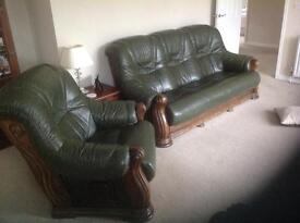 Green leather three piece suite with storage footstall.