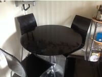 Black High Gloss table with four chairs