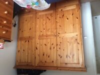 Pine wardrobe, chest of drawers and mirror