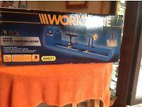 Workzone 400w wood turning lathe with 3 piece chisel set. Unopened box and unused.