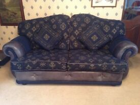 3 & 2 seater sofas. Blue fabric with gray leather trim.