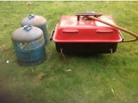 Small scruffy gas barbecue with 2 camping gas 904 bottles and bottle adaptor.