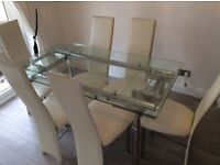 Glass extending dinning room table with 6 chairs