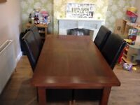 Solid wood dining table and 6 full leather chairs